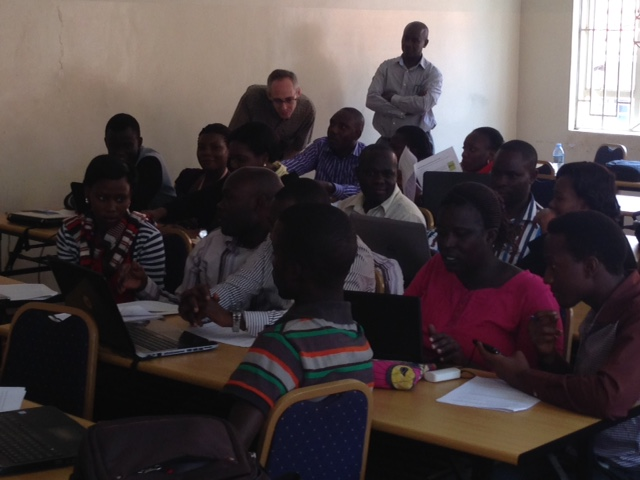 Participant at Makerere University Training explains an issue to Matt Sobek while Professor Edward Kaweesi looks on (Photo by Ann Meier).]