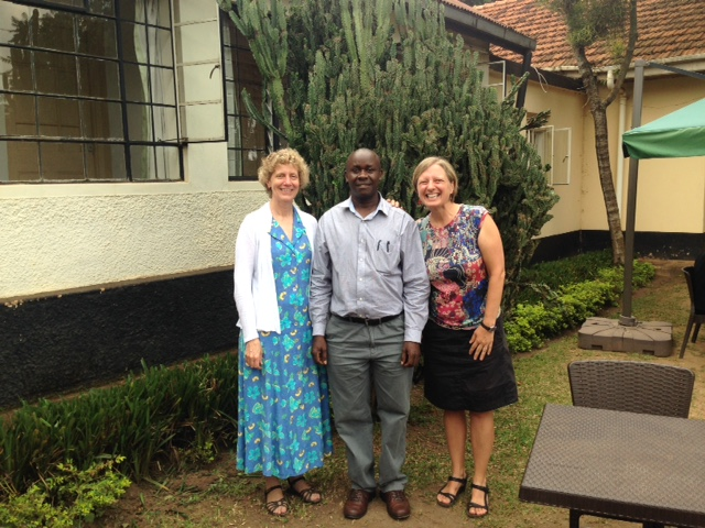 Caption: Liz Boyle and Ann Meier with Dean of Social Sciences Andrew State, Makerere University (photo by Matt Sobek).