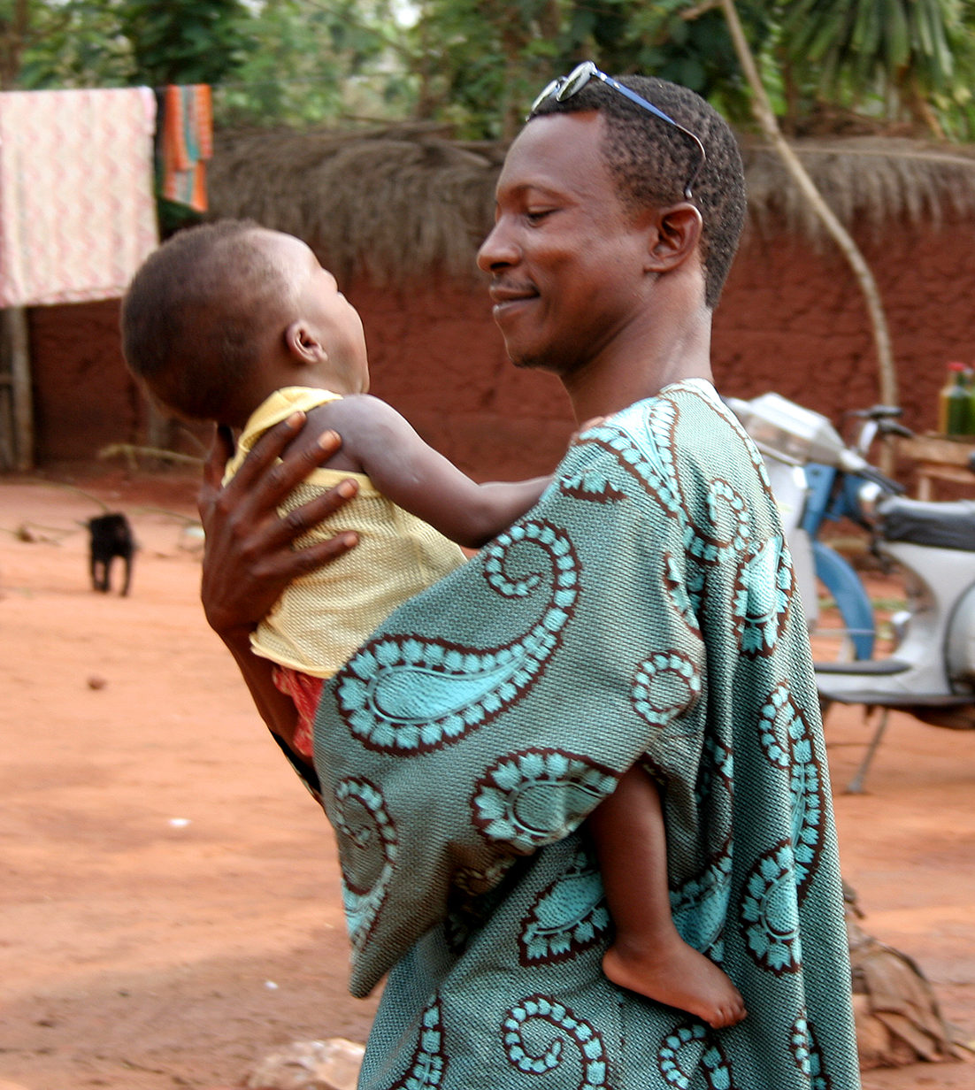 African man holding baby