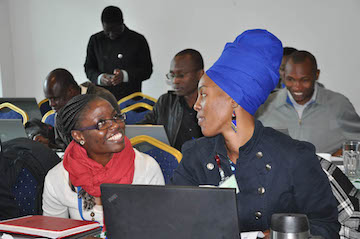 Joyce Mumah, Associate Research Scientist, APHRC, and Marilyn Wamukoya, Data Analyst, APHRC, work together on an exercise at the Nairobi training (photo by APHRC).